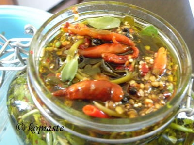 jar with pickled purslane and spices