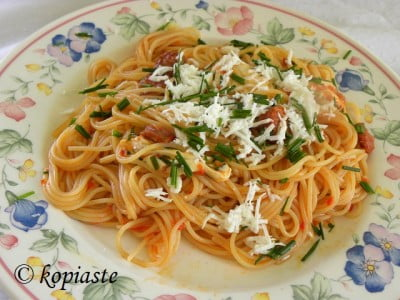 Spaghetti with sausages and buffalo cheese